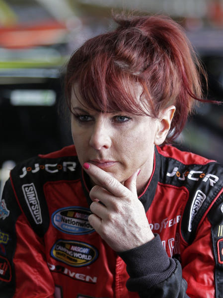 Jennifer Jo Cobb looks out of the garage area before practice for the NASCAR Truck series North Carolina Education Lottery 200 auto race at Charlotte Motor Speedway in Concord, N.C., Thursday, May 16, 2013. After having her trailer stolen, truck racer Jennifer Jo Cobb is hoping to find replacement equipment in time to race this weekend. (AP Photo/Chuck Burton)