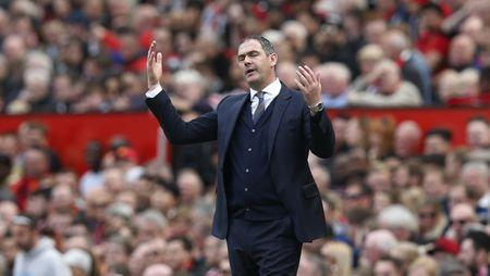 Swansea City manager Paul Clement looks dejected