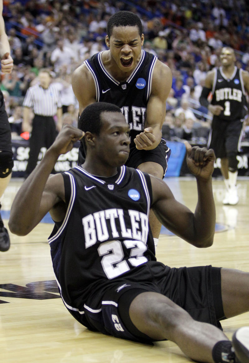 Butler's Khyle Marshall reacts with Ronald Nored after Marshall made a basket during overtime of the NCAA Southeast regional college basketball championship game against Florida Saturday, March 26, 2011, in New Orleans. (AP Photo/Patrick Semansky)