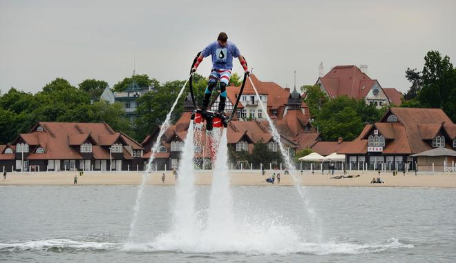 A man with hydro shoes flies over the water at a beach on the Baltic Sea in Sopot on June 7, 2012 on the eve of the Euro 2012 championships opening football match.       AFP PHOTO / PATRIK STOLLARZPATRIK STOLLARZ/AFP/GettyImages