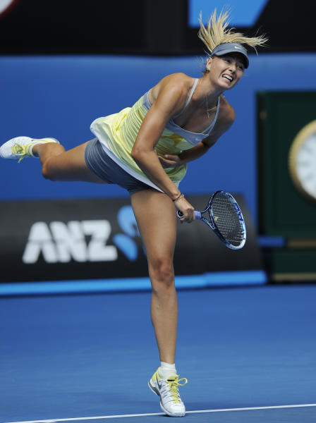 Russia's Maria Sharapova serves to compatriot Olga Puchkova during their first round match at the Australian Open tennis championship in Melbourne, Australia, Monday, Jan. 14, 2013. (AP Photo/Andrew Brownbill)