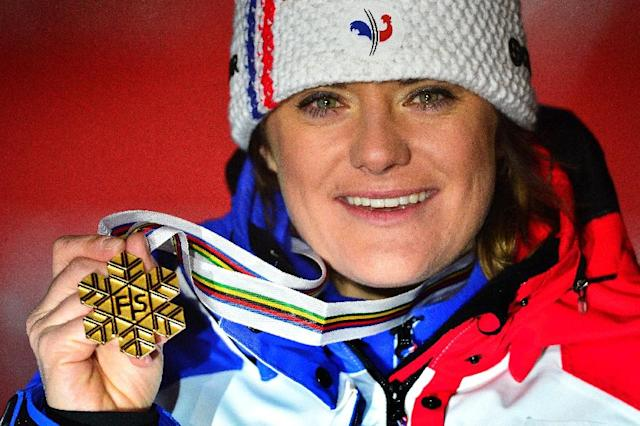 France's Marion Rolland celebrates with her gold medal after the women's downhill event of the 2013 Ski World Championships in Schladming, Austria (AFP Photo/Fabrice Coffrini)