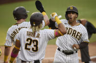 San Diego Padres' Trent Grisham, right, celebrates with Jake Cronenworth, left, and Fernando Tatis Jr. after a three-run home run during the second inning of the team's baseball game against the Houston Astros in San Diego, Saturday, Aug. 22, 2020. (AP Photo/Kelvin Kuo)