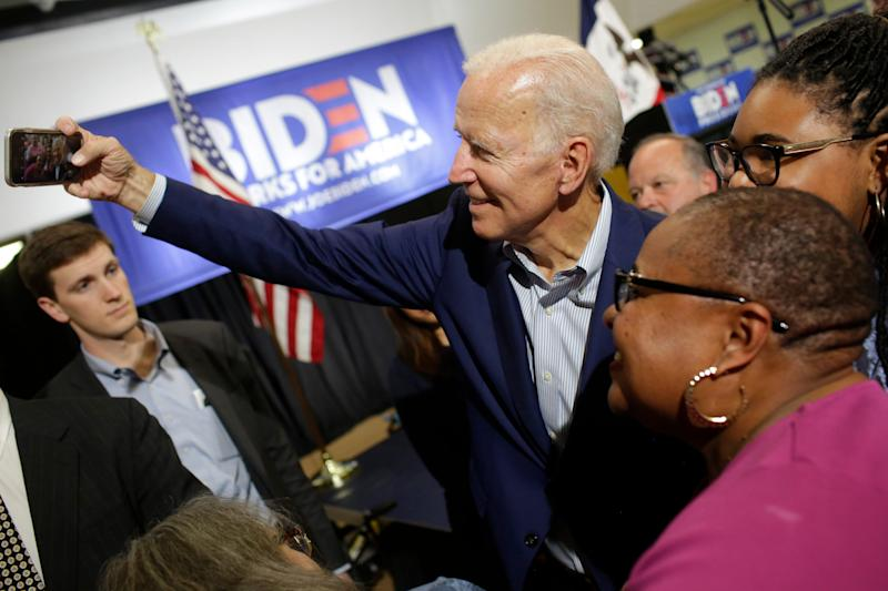 Former vice president and 2020 Democratic presidential candidate Joe Biden takes a selfie attendees during a campaign event on June 11, 2019 in Davenport, Iowa. Biden and over two dozen presidential candidates are seeking the Democratic nomination to challenge Republican President Donald Trump during the 2020 general election.