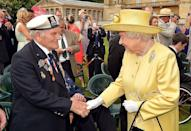 """<p>Here she shakes the hand of a war veteran at her """"Not Forgotten"""" Garden Party, a charity event to support ex service personnel.<br></p>"""