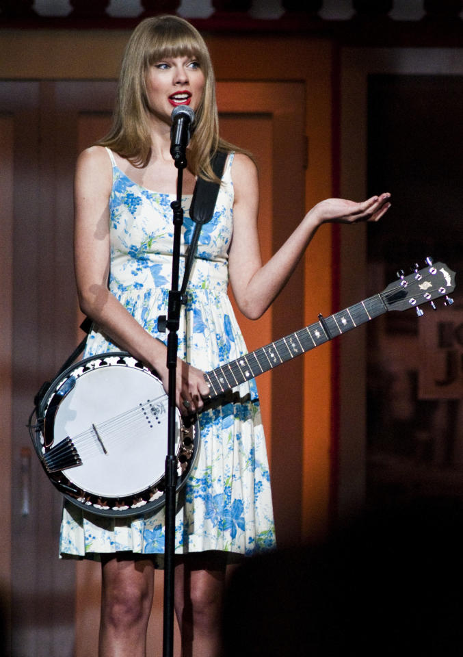 Grammy winning artist Taylor Swift performs during the Wal-Mart Stores Inc. shareholders' meeting in Fayetteville, Ark., Friday, June 1, 2012. Wal-Mart Stores Inc. CEO Mike Duke said Friday that the retailer is committed to integrity in the wake of recent bribery allegations in Mexico. (AP Photo/April L. Brown)(AP Photo/April L. Brown)
