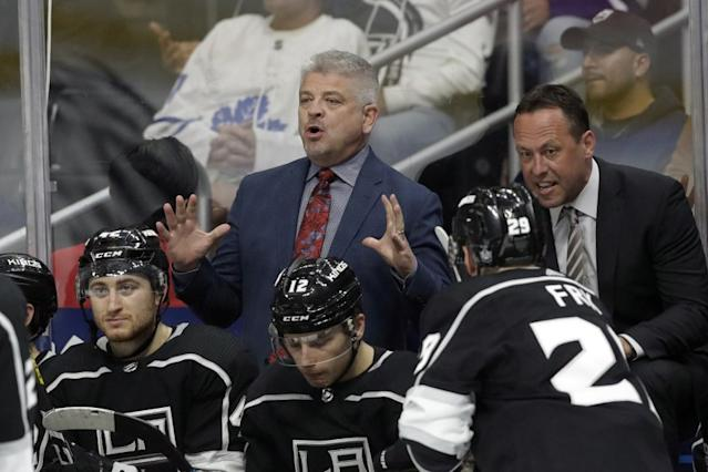 """Kings coach Todd McLellan, center, and assistant coach Marco Sturm instruct players against the Toronto Maple Leafs on March 5. <span class=""""copyright"""">(Marcio Jose Sanchez / Associated Press)</span>"""