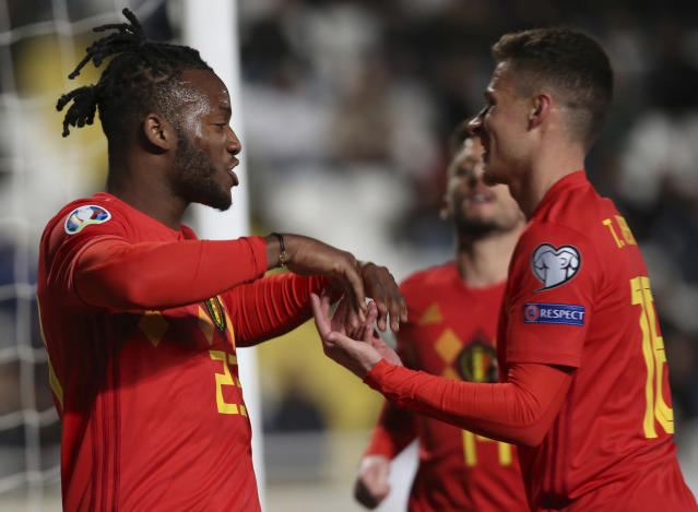 Belgium player Michy Batshuayi, left, celebrates a goal against Cyprus during the Euro 2020 group I qualifying soccer match between Cyprus and Belgium at the GSP stadium in Nicosia, Cyprus, Sunday, March 24, 2019. (AP Photo/Philippos Christou)