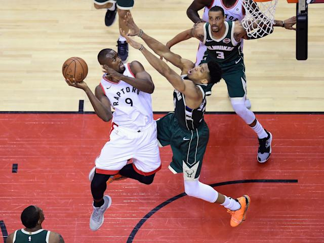 Raptors center Serge Ibaka played only 14 minutes Sunday night, but he made a major contribution another way. (Frank Gunn/The Canadian Press via AP)