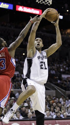 REMOVES FIRST-ROUND FROM DESCRIPTION - San Antonio Spurs' Tim Duncan (21) shoots past Los Angeles Clippers' Chris Paul during the first quarter of Game 1 of an NBA basketball Western Conference semifinal playoff series, Tuesday, May 15, 2012, in San Antonio. (AP Photo/Eric Gay)