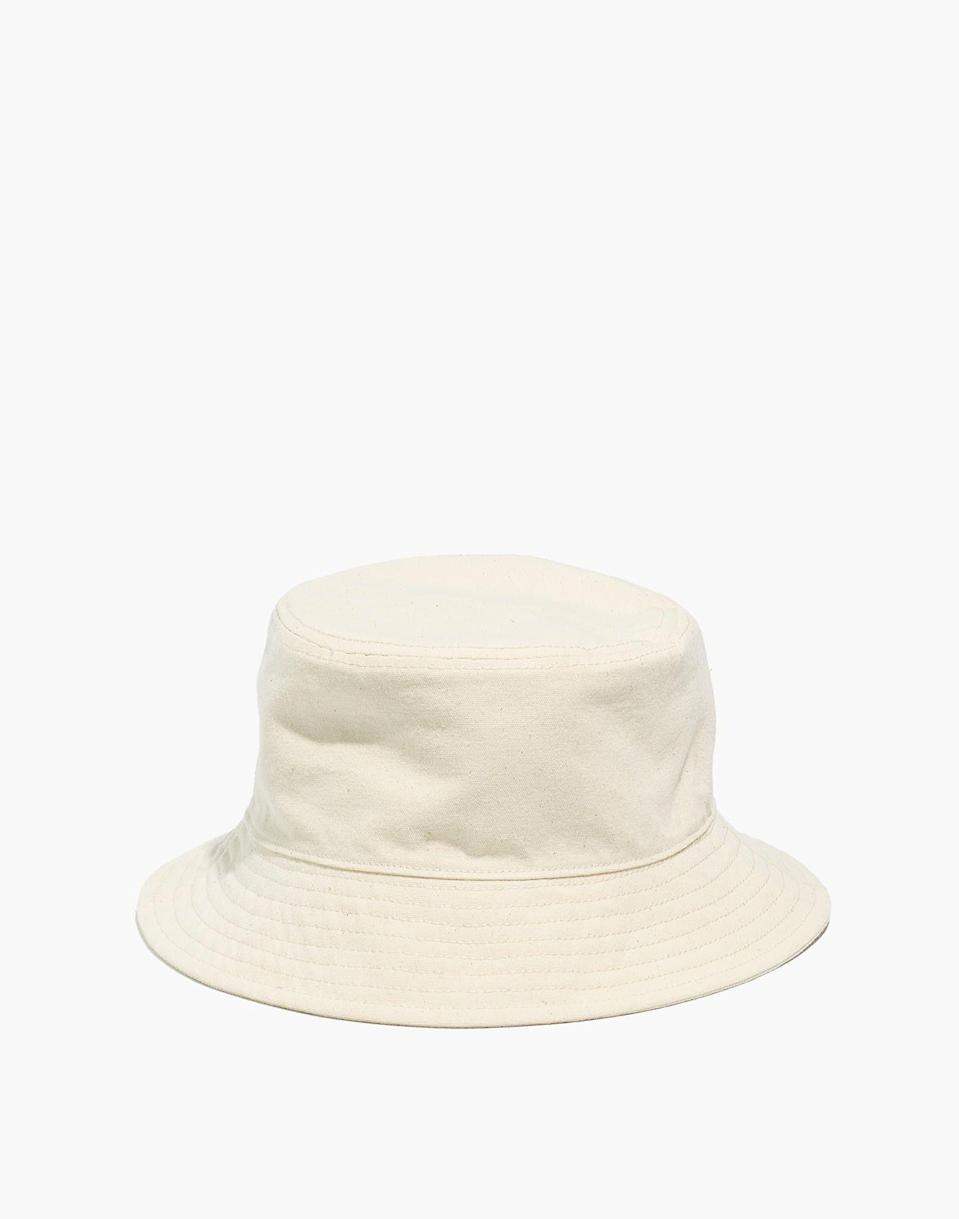 """<p><strong>Madewell</strong></p><p>madewell.com</p><p><strong>$22.50</strong></p><p><a href=""""https://go.redirectingat.com?id=74968X1596630&url=https%3A%2F%2Fwww.madewell.com%2Freversible-short-brimmed-bucket-hat-AL543.html&sref=https%3A%2F%2Fwww.elle.com%2Ffashion%2Fshopping%2Fg33350117%2Fmadewell-sale-july-2020%2F"""" rel=""""nofollow noopener"""" target=""""_blank"""" data-ylk=""""slk:Shop Now"""" class=""""link rapid-noclick-resp"""">Shop Now</a></p><p><strong><del>$29.50</del> <del>$24.50</del> $15</strong></p><p>You'd be more hard-pressed to find a cool fashion girl who hasn't taken the bucket hat trend for a spin. At $15, now's the best time to finally try the look out for yourself. </p>"""