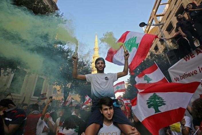 Lebanese protests have grown into an unprecedented cross-sectarian street mobilisation against the political class (AFP Photo/Anwar AMRO)
