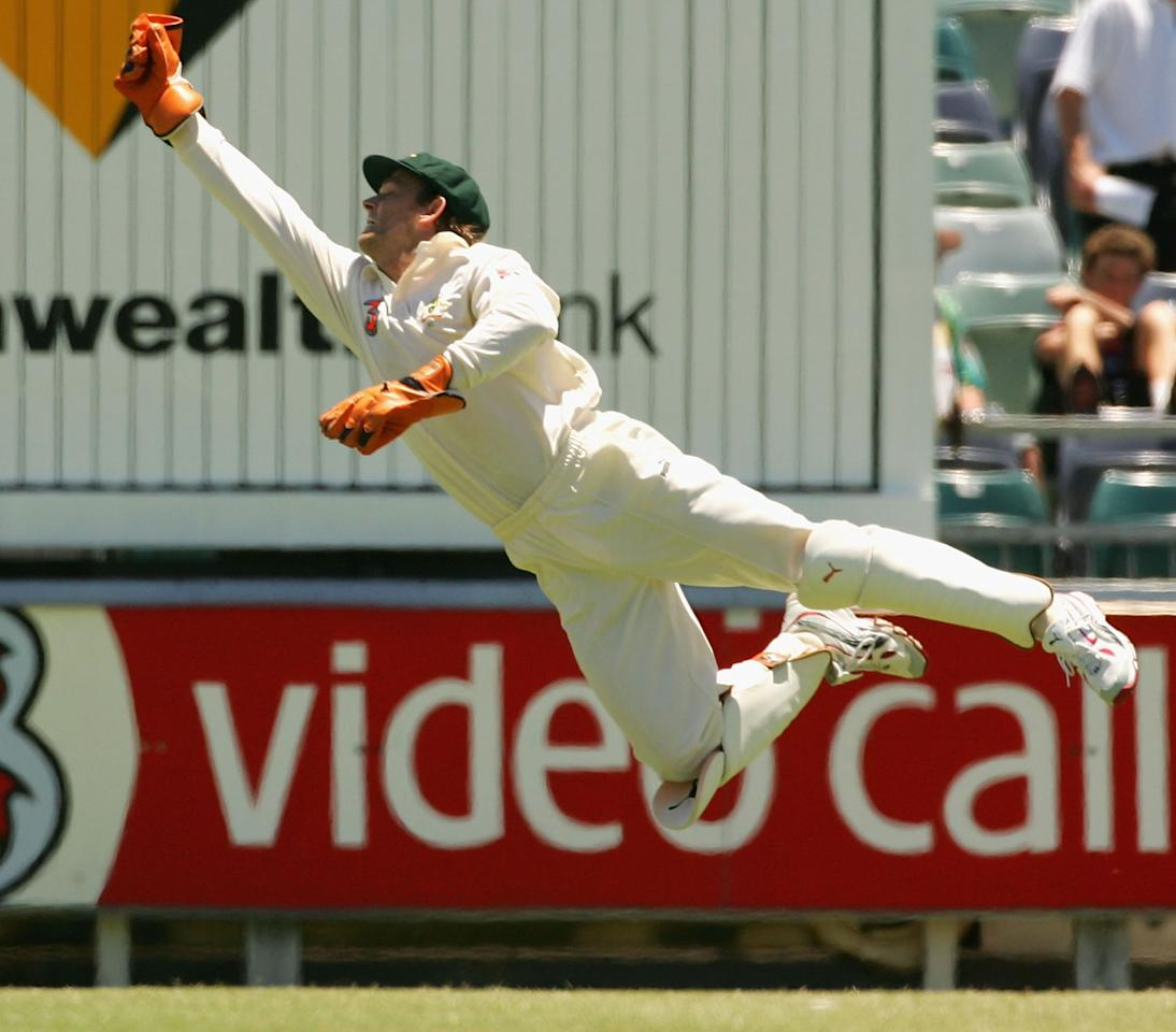 PERTH, AUSTRALIA - DECEMBER 17:  Adam Gilchrist of Australia dives after a the ball during day two of the First Test between Australia and Pakistan on December 17, 2004 at the WACA in Perth, Australia.  (Photo by Hamish Blair/Getty Images)
