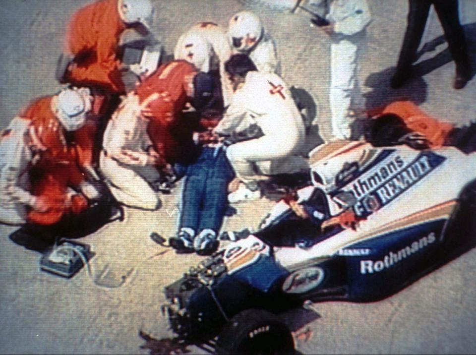 FILE - In this May 1,1994 file image from TV, rescue crew members give first aid to unconscious formula one driver Ayrton Senna, lying mortally injured, beside his wrecked car after the Brazilian driver crashed against the course wall during the Grand Prix of San Marino in Imola, Italy. Italy's Imola circuit is planning to honor the three-time F1 champion on the 20th anniversary of his death. (AP Photo/File)