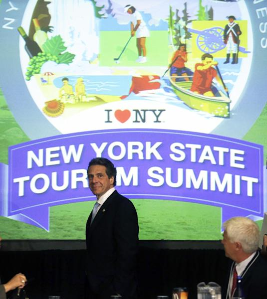 New York Gov. Andrew Cuomo arrives for the New York State Tourism Summit on Wednesday, May 8, 2013, in Albany, N.Y. The governor is trying to map out a better way to showcase New York state's seasonal attractions and boost businesses. The focus will range from summer attractions such as Niagara Falls, the Erie Canal and Adirondacks to the rebuilding of boardwalks and beaches on Long Island hit hard by Superstorm Sandy last fall. (AP Photo/Mike Groll)