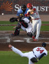 St. Louis Cardinals' Paul DeJong hits a double to score teammate Tommy Edman off Atlanta Braves pitcher Max Fried (54) during the second inning of Game 5 of their National League Division Series baseball game Wednesday, Oct. 9, 2019, in Atlanta. (AP Photo/Danny Karnik)