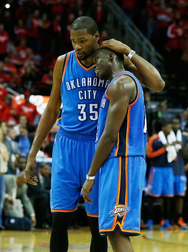 HOUSTON, TX - MAY 03:  Kevin Durant #35 and Reggie Jackson #15 of the Oklahoma City Thunder wait on the court late in the game against the Houston Rockets in Game Six of the Western Conference Quarterfinals of the 2013 NBA Playoffs at the Toyota Center on May 3, 2013 in Houston, Texas. (Photo by Scott Halleran/Getty Images)