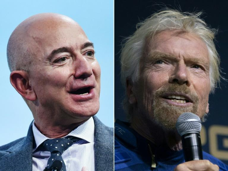 The competition in the space tourism sector, whose imminent advent has been announced for years, has come to a head: Jeff Bezos (L) is set to fly just days after Richard Branson