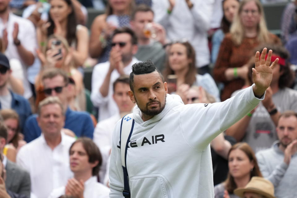 Australia's Nick Kyrgios leaves the court after retiring from the men's singles third round match against Canada's Felix Auger-Aliassime on day six of the Wimbledon Tennis Championships in London, Saturday July 3, 2021. (AP Photo/Alberto Pezzali)