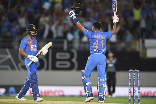 India's Manish Pandy and Shreyas Iyer, right, celebrate during the Twenty/20 cricket international between India and New Zealand in Auckland, New Zealand, Friday, Jan. 24, 2020. (Andrew Cornaga/Photosport via AP)