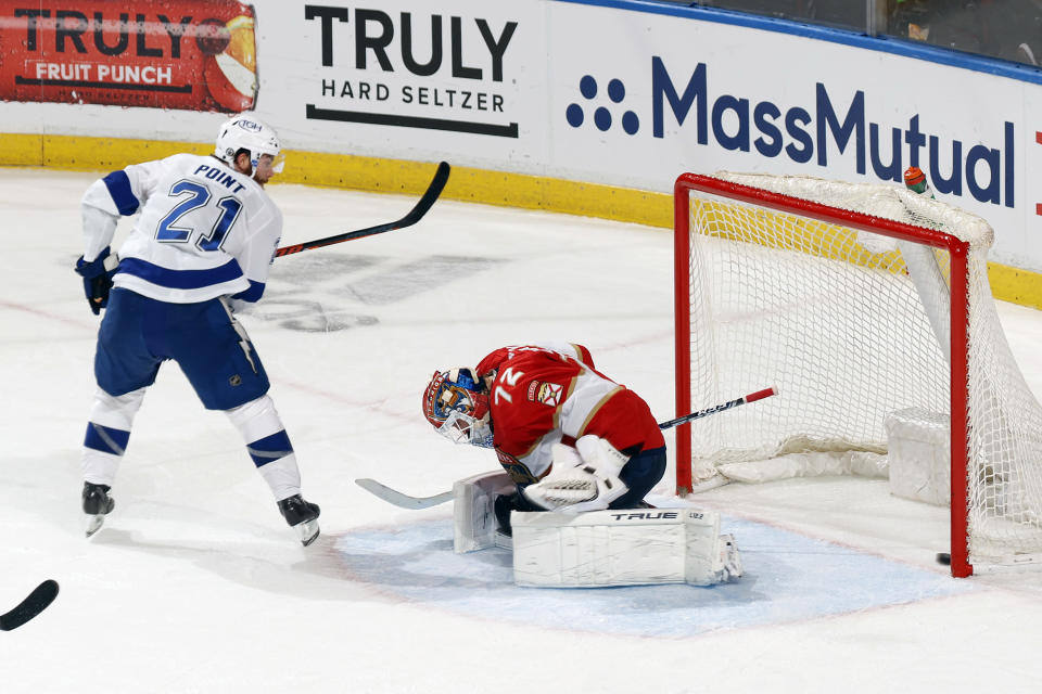 Tampa Bay Lightning defenseman Brayden Point (21) scores the go-ahead and eventual game-winning goal past Florida Panthers goaltender Sergei Bobrovsky (72) during the third period in Game 1 of an NHL hockey Stanley Cup first-round playoff series, Sunday, May 16, 2021, in Sunrise, Fla. (AP Photo/Joel Auerbach)
