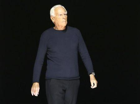Italian designer Giorgio Armani acknowledges the applause at the end of his Autumn/Winter 2016 women's collection during Milan Fashion Week