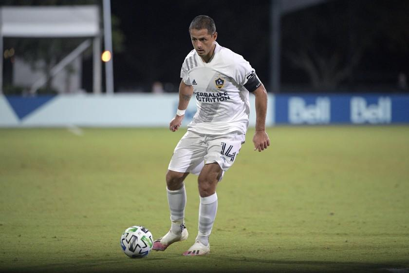 LA Galaxy forward Chicharito (14) controls the ball during the second half of an MLS soccer match against the Portland Timbers, Monday, July 13, 2020, in Kissimmee, Fla. (AP Photo/Phelan M. Ebenhack)