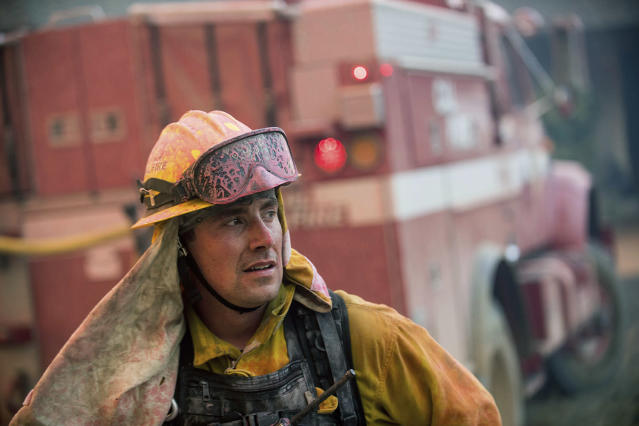 <p>CalFire firefighter Jake Hainey battles a wildfire near Oroville, Calif., on Saturday, July 8, 2017. The fire was one of more than a dozen burning in the state as firefighters worked in scorching temperatures to control unruly flames. (AP Photo/Noah Berger) </p>