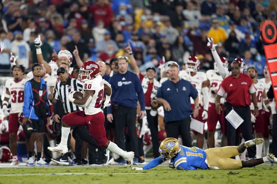 Fresno State running back Ronnie Rivers (20) runs past UCLA defensive back DJ Warnell (14) to score a rushing touchdown during the first half of an NCAA college football game Saturday, Sept. 18, 2021, in Pasadena, Calif. (AP Photo/Marcio Jose Sanchez)