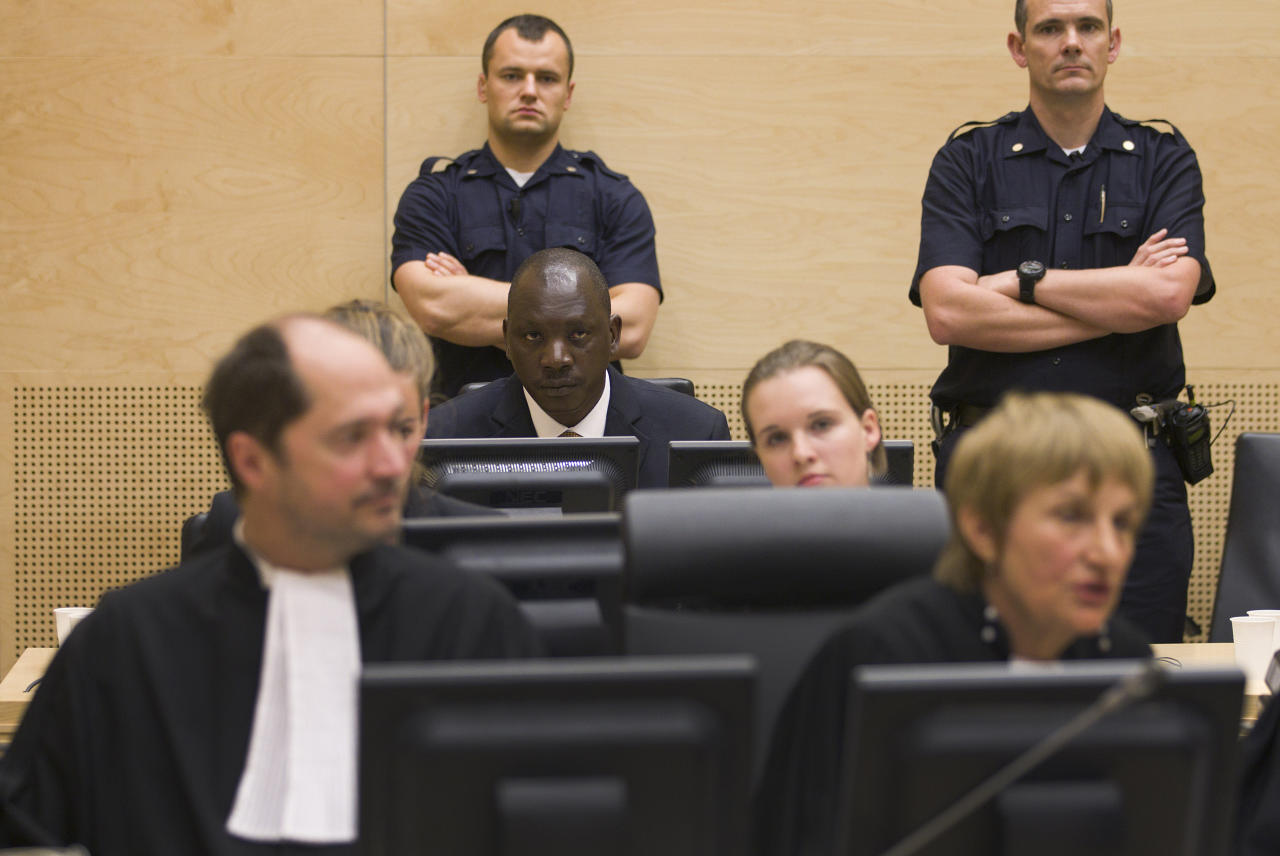 Congolese warlord Thomas Lubanga(back row) sits in the courtroom of the International Congolese warlord Thomas Lubanga sits in the courtroom of the International Criminal Court (ICC) in The Hague, Netherlands, Thursday, Aug. 25, 2011. Prosecution lawyers are wrapping up the ICC's landmark first trial by urging judges to convict Lubanga of recruiting child soldiers and sending them to fight in his country's brutal conflict. Lubanga's trial was the first international case to focus exclusively on child soldiers. (AP Photo/Michael Kooren, Pool)