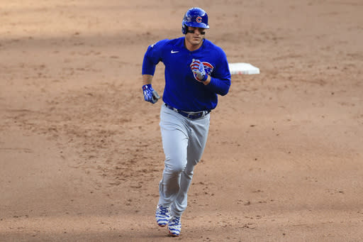 Chicago Cubs' Anthony Rizzo runs the bases after hitting a solo home run in the sixth inning during a baseball game against the Cincinnati Reds in Cincinnati, Saturday, Aug. 29, 2020. (AP Photo/Aaron Doster)