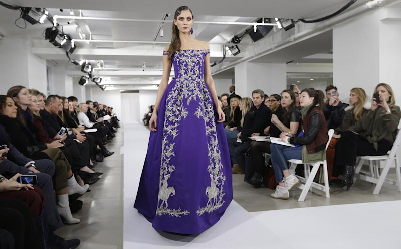 FILE - This Feb. 12, 2013 file photo shows model Karlie Kloss modeling a dress from the Oscar de la Renta Fall 2013 collection during Fashion Week in New York. Kloss is a favorite finale model, closing the catwalk again Wednesday at Michael Kors at New York Fashion Week. She did the same the night before, escorting Oscar de la Renta for his bow. It's these close ties to fashion designers that had put her on the red-eye after the Grammy Awards on Sunday, so she could make it Carolina Herrera's runway bright and early the next morning. (AP Photo/Kathy Willens, file)