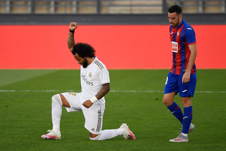Real Madrid defender Marcelo kneels after scoring in Saturday's La Liga match against Eibar. (Pierre-Philippe Marcou/Getty Images)