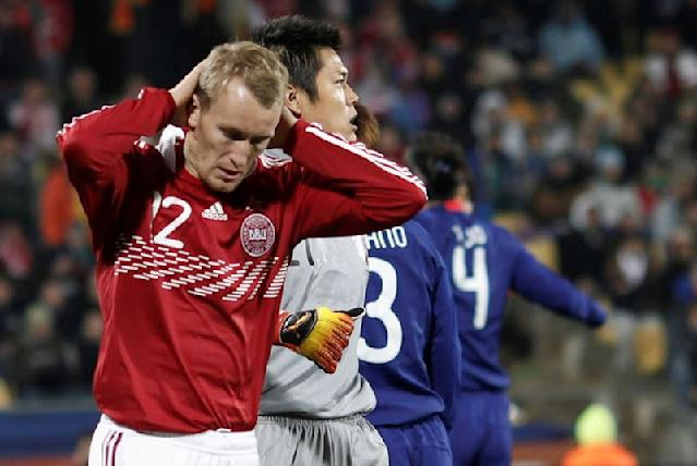 FILE PHOTO: Denmark's Thomas Kahlenberg (L) reacts after his effort go off target during the 2010 World Cup Group E soccer match against Japan at Royal Bafokeng stadium in Rustenburg
