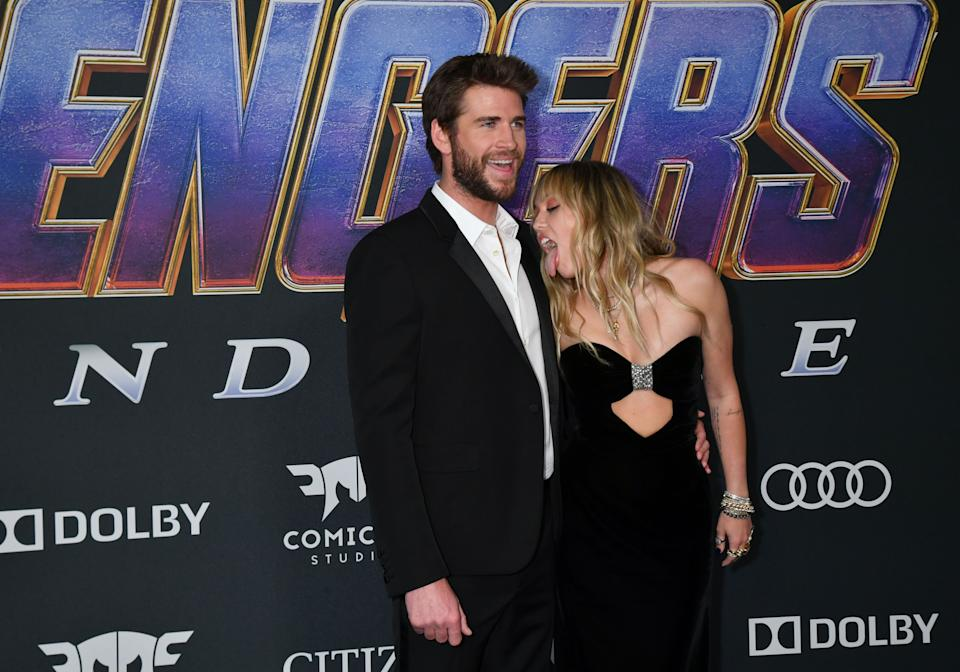 Miley Cyrus licks Liam Hemsworth at the Avengers premiere