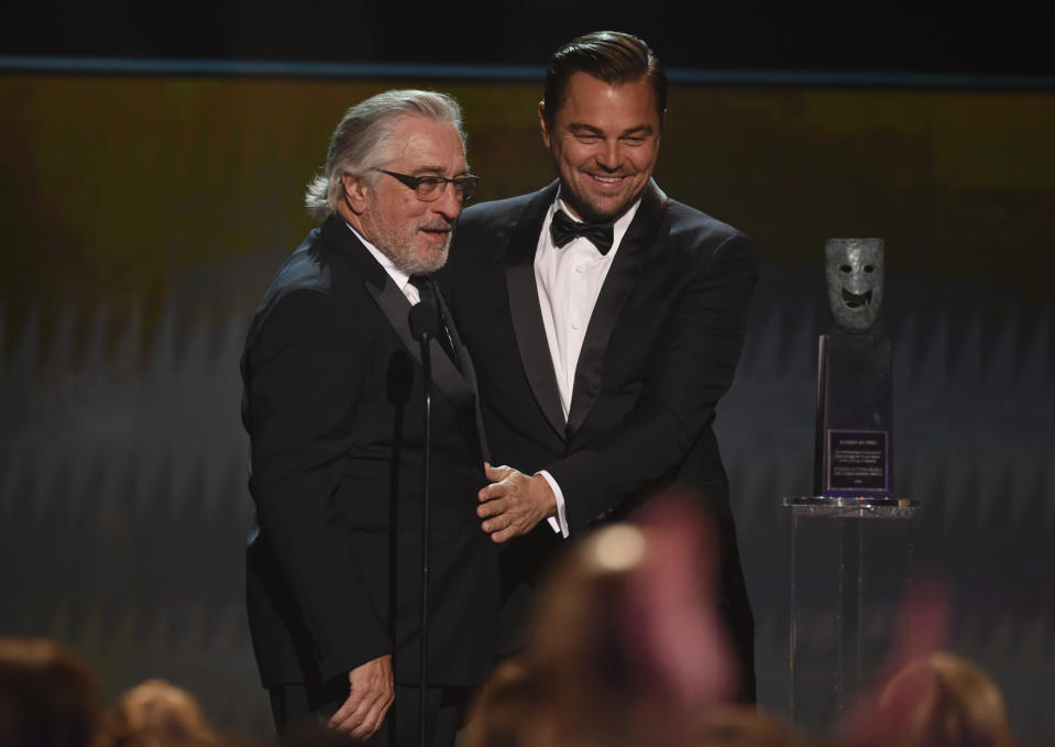 Leonardo DiCaprio, right, presents the lifetime achievement award to Robert De Niro at the 26th annual Screen Actors Guild Awards at the Shrine Auditorium & Expo Hall on Sunday, Jan. 19, 2020, in Los Angeles. (Photo/Chris Pizzello)
