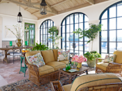 """<p><a href=""""https://www.betsyshiverickinteriors.com/"""" rel=""""nofollow noopener"""" target=""""_blank"""" data-ylk=""""slk:Betsy Shiverick"""" class=""""link rapid-noclick-resp"""">Betsy Shiverick</a> worked with architect <a href=""""https://www.fairfaxandsammons.com/"""" rel=""""nofollow noopener"""" target=""""_blank"""" data-ylk=""""slk:Richard Sammons"""" class=""""link rapid-noclick-resp"""">Richard Sammons</a> to design this Italianate-style, five-bedroom home overlooking the Lake Worth Lagoon. """"We wanted a real Florida house, done to reflect the way we live, which includes our dogs,"""" explains Shiverick, who opted for less formal furnishings and colorful textiles. The vintage sofa and chairs on the loggia have cushions in a <a href=""""https://www.pierrefrey.com/en/"""" rel=""""nofollow noopener"""" target=""""_blank"""" data-ylk=""""slk:Pierre Frey"""" class=""""link rapid-noclick-resp"""">Pierre Frey</a> fabric. </p><p><a class=""""link rapid-noclick-resp"""" href=""""https://www.veranda.com/decorating-ideas/a25422820/0074-0081-court-of-appeal-january-2019/"""" rel=""""nofollow noopener"""" target=""""_blank"""" data-ylk=""""slk:Tour the Home"""">Tour the Home</a></p>"""