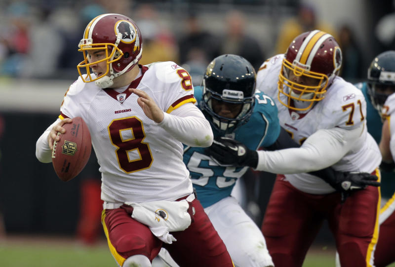 Washington Redskins quarterback Rex Grossman (8) scrambles to get away from Jacksonville Jaguars defensive end Larry Hart (59) as Washington Redskins' Trent Williams (71) tries to block during the second half of an NFL football game in Jacksonville, Fla., Sunday, Dec. 26, 2010. Washington won 20-17 in overtime.(AP Photo/John Raoux)
