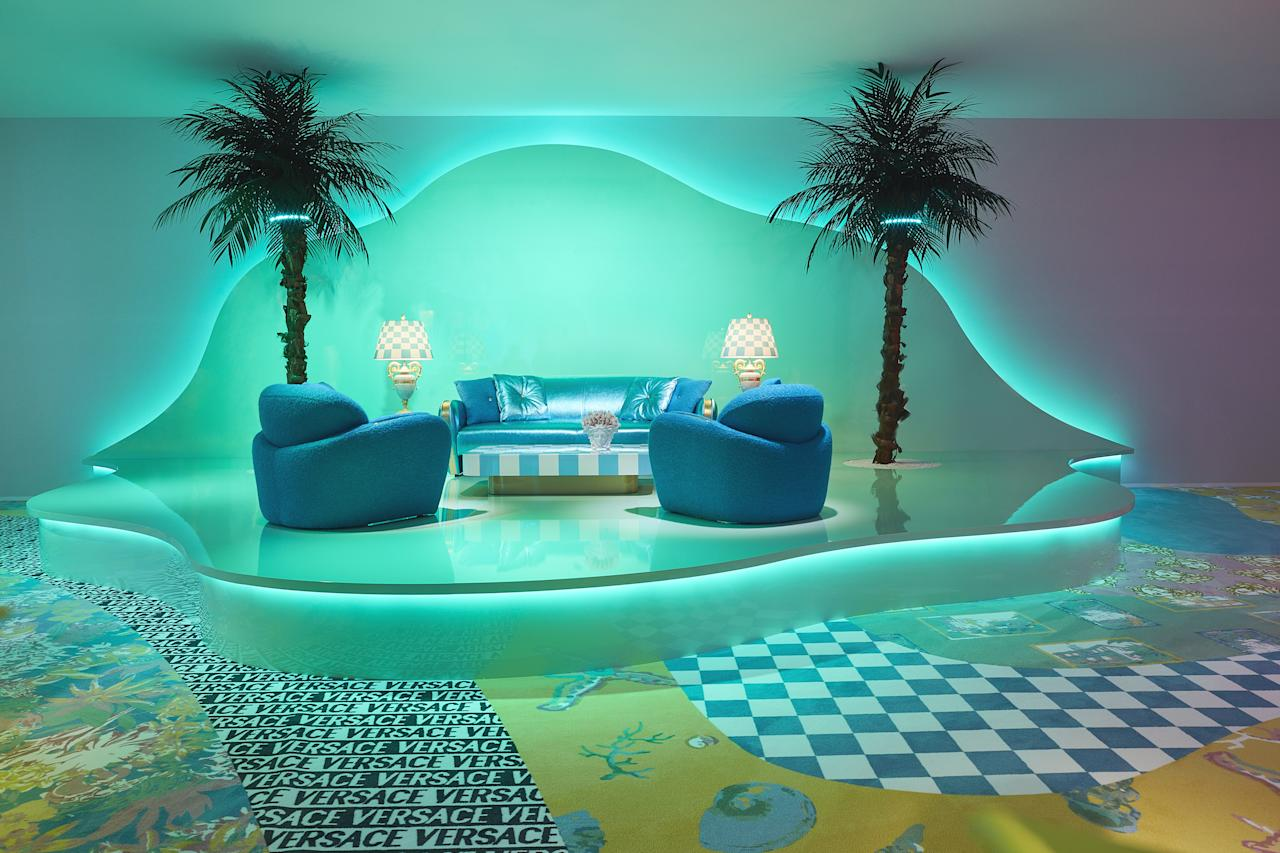 """At the Versace palazzo in Milan, the fashion house and designer <a href=""""https://www.architecturaldigest.com/story/sasha-bikoff?mbid=synd_yahoo_rss"""" rel=""""nofollow"""">Sasha Bikoff</a> created an installation to celebrate <a href=""""https://www.versace.com/us/en-us/home-collection/"""" rel=""""nofollow"""">Versace's latest home collection</a> in collaboration with artist Andy Dixon. We can only call it Memphis Group–meets–outer space. We're not surprised we love the <a href=""""https://www.architecturaldigest.com/gallery/this-2019-trend-goes-with-everything?mbid=synd_yahoo_rss"""" rel=""""nofollow"""">curvy</a> platforms backlit with neon, but who knew that we'd suddenly have patchwork wall-to-wall carpeting on our wish lists? <a href=""""https://www.architecturaldigest.com/story/versace-and-sasha-bikoff-create-a-maximalist-paradise-at-milan-design-week?mbid=synd_yahoo_rss"""" rel=""""nofollow"""">According to AD PRO</a>, Sasha made the wavy pattern just for this exhibit using the brand's 1980s textiles. Designing your own custom carpet might not be in the budget, but the <a href=""""https://kindermodern.com/kinder-ground-modular-rugs-1"""" rel=""""nofollow"""">wacky modular rug tiles by Kinder Ground</a> are a good alternative."""