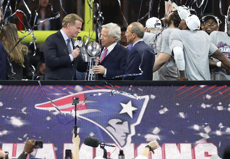 Feb 3, 2019; Atlanta, GA, USA; New England Patriots owner Robert Kraft (middle) accepts the Vince Lombardi trophy from NFL commissioner Roger Goodell (left) after defeating the Los Angeles Rams in Super Bowl LIII at Mercedes-Benz Stadium. Mandatory Credit: Jason Getz-USA TODAY Sports