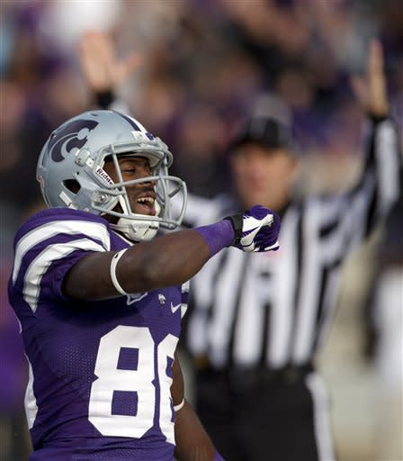 Kansas State wide receiver Tramaine Thompson (86) celebrates a touchdown during the second half of an NCAA college football game against Texas Tech in Manhattan, Kan., Saturday, Oct. 27, 2012. (AP Photo/Orlin Wagner)