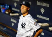 Derek Jeter #2 of the New York Yankees looks on before a game against the Tampa Bay Rays at Yankee Stadium on September 25, 2013 in the Bronx borough of New York City. The Rays defeated the Yankees 8-3. (Photo by Jim McIsaac/Getty Images)