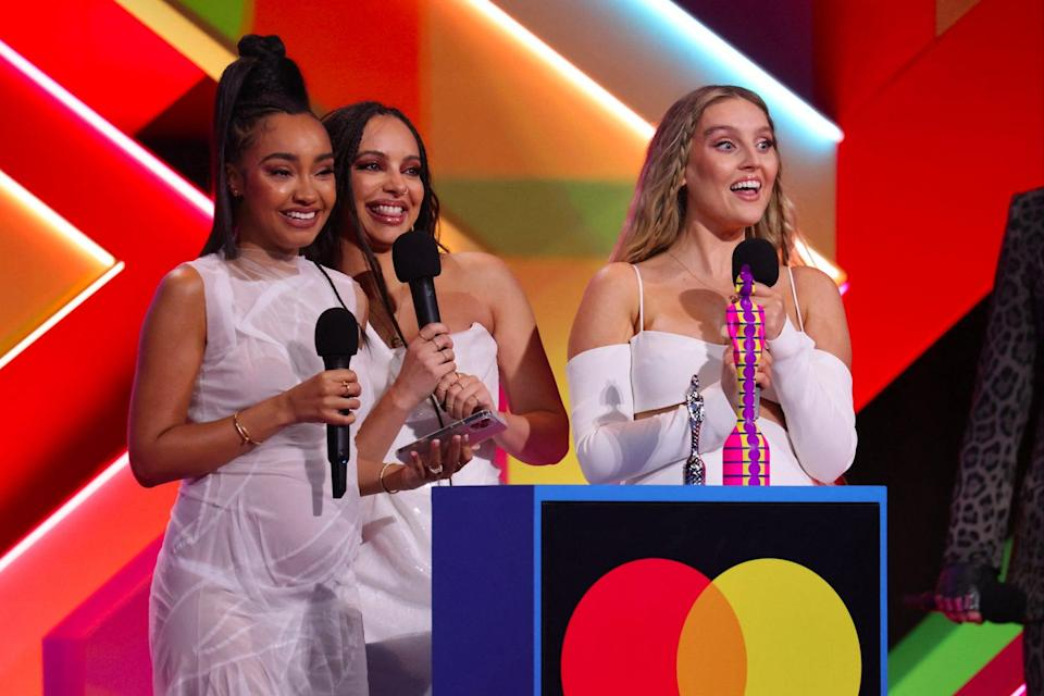 Leigh-Anne Pinnock, Jade Thirlwall and Perrie Edwards of Little Mix accept their British Group award during the BRIT Awards 2021 (John Marshall/AFP via Getty Imag)