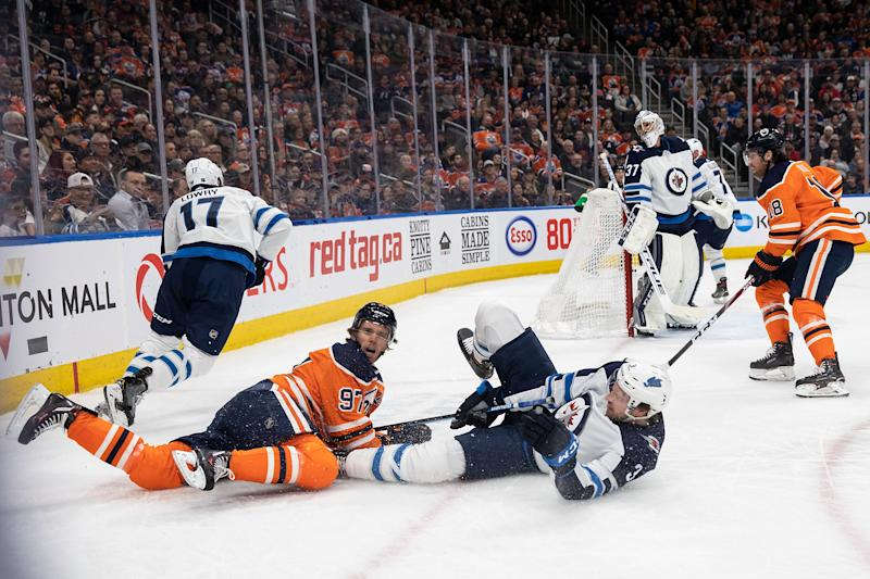 EDMONTON, AB - MARCH 11: Connor McDavid #97 of the Edmonton Oilers battles against Tucker Poolman #3 of the Winnipeg Jets at Rogers Place on March 11, 2020, in Edmonton, Canada. (Photo by Codie McLachlan/Getty Images)