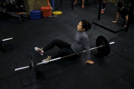Kim Jin-ah, 31, rests as she takes part in a crossfit class at a gym in Seoul, September 11, 2015. REUTERS/Kim Hong-Ji