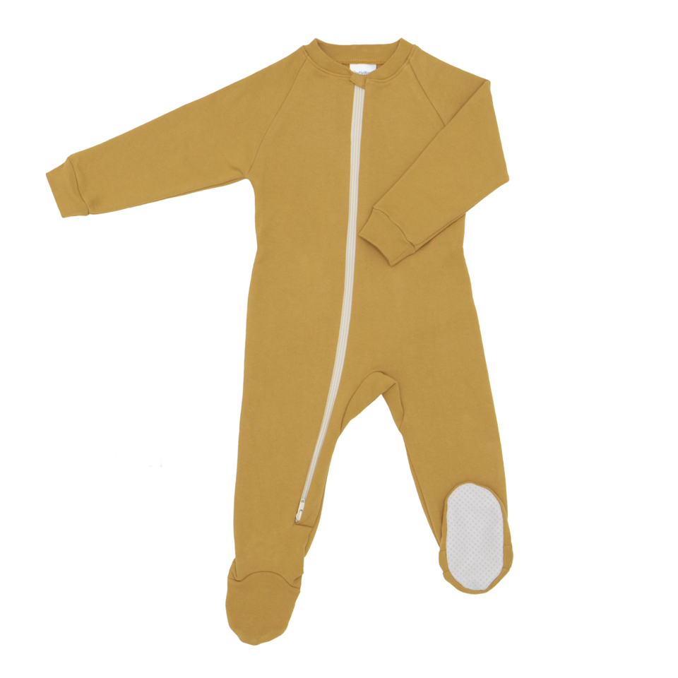 """These are hands-down the best pajamas out there. It's nearly impossible to find warm pajamas that don't have polyester in them, and these are 100% organic cotton. I give these to all of my pregnant friends because they always end up loving them as much as I do! They keep the baby toasty warm without overheating because they're breathable. —<a href=""""https://www.instagram.com/jenkay/"""" rel=""""nofollow noopener"""" target=""""_blank"""" data-ylk=""""slk:Jen Kay"""" class=""""link rapid-noclick-resp""""><em>Jen Kay</em></a><em>, commercial photographer and art director</em> $51, Castleware. <a href=""""https://castleware.com/collections/footies/products/striped-fleece-footies"""" rel=""""nofollow noopener"""" target=""""_blank"""" data-ylk=""""slk:Get it now!"""" class=""""link rapid-noclick-resp"""">Get it now!</a>"""
