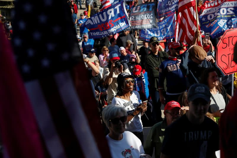 Supporters of U.S. President Donald Trump rally outside the State Capitol building as votes continue to be counted following the 2020 U.S. presidential election, in Lansing