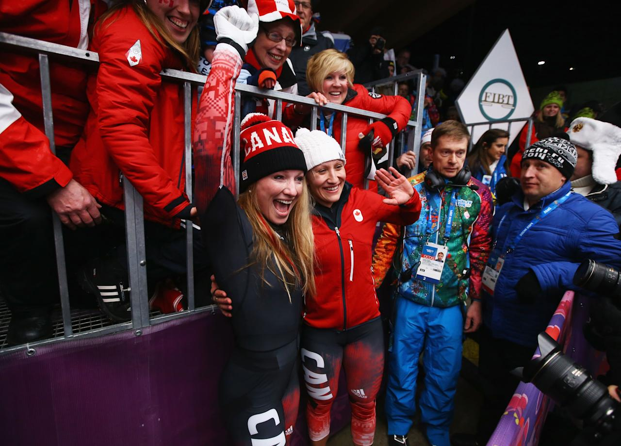 SOCHI, RUSSIA - FEBRUARY 19: Kaillie Humphries and Heather Moyse (L) of Canada team 1 celebrate after winning the gold medal during the Women's Bobsleigh on Day 12 of the Sochi 2014 Winter Olympics at Sliding Center Sanki on February 19, 2014 in Sochi, Russia. (Photo by Al Bello/Getty Images)