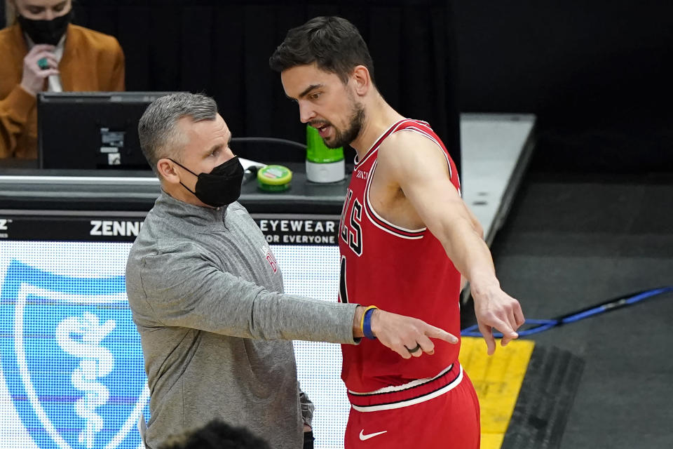 Chicago Bulls head coach Billy Donovan, left, talks with guard Tomas Satoransky during the first half of an NBA basketball game against the Miami Heat in Chicago, Friday, March 12, 2021. (AP Photo/Nam Y. Huh)