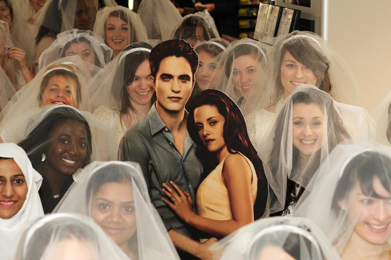 LONDON, ENGLAND - MARCH 11:  Entertainment One is attempting to set the Guinness World Record for the longest chain of brides in one location at HMV Oxford Street on March 11, 2012 in London, United Kingdom. The event was held to celebrate to celebrate the DVD release of The Twilight Saga: Twilight Breaking Dawn Part 1  (Photo by Dave J Hogan/Getty Images)
